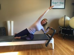 A woman relieivng stress with Pilates